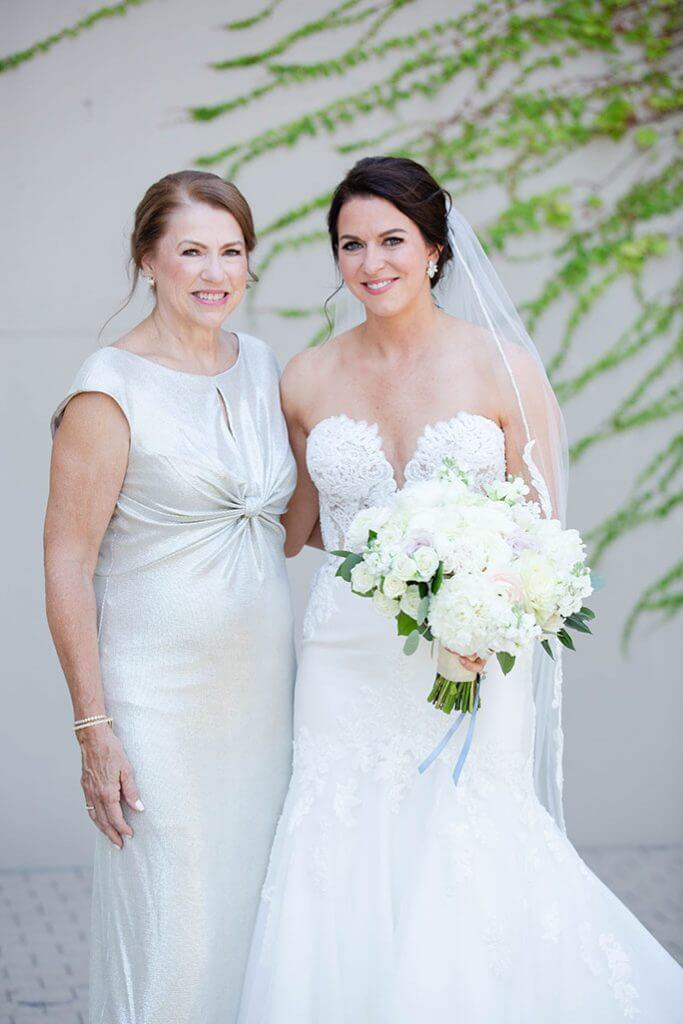 Real Belle Vogue Bride Bonnie wearing a Martina Liana wedding dress, style 906, posing with her Mom.