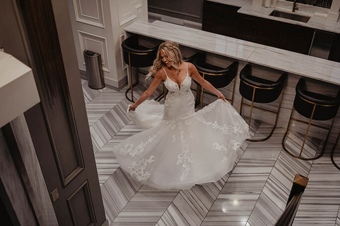 Real Bride Brittany spinning in her designer Martina Liana wedding dress, style 906.