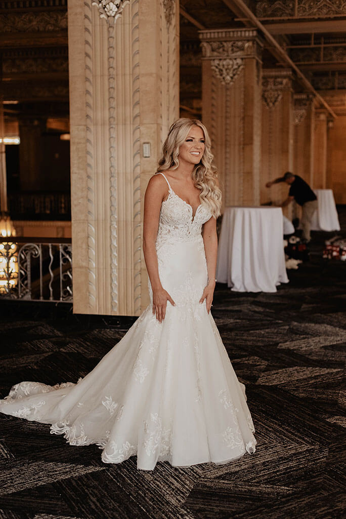Real Belle Vogue Bride, Brittany, wearing a textured mermaid wedding dress from designer Martina Liana, style 906.
