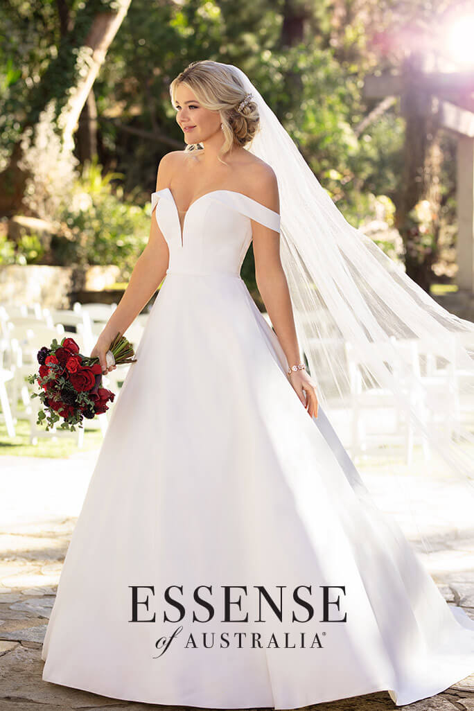 Bride standing outside in the Spring wearing an Essense of Australia wedding dress, style D2761