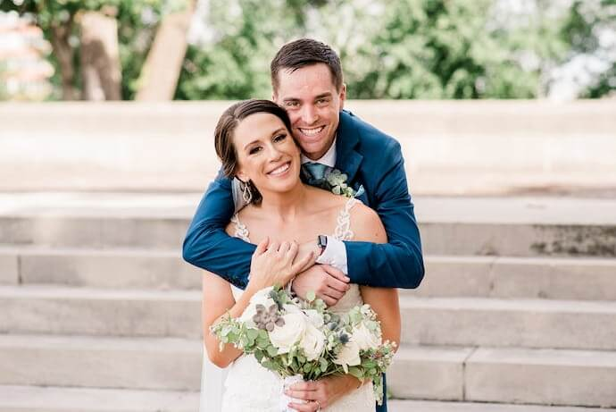 Real Belle Vogue Bride Stephanie, posing with her groom to be, wearing her Essense of Austalia wedding gown, style D2452.