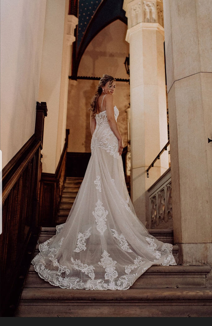 Belle Vogue Bride Alison walking up the stairs at the Marienburg Castle in Germany, wearing her Essense of Australia wedding dress, style D2819