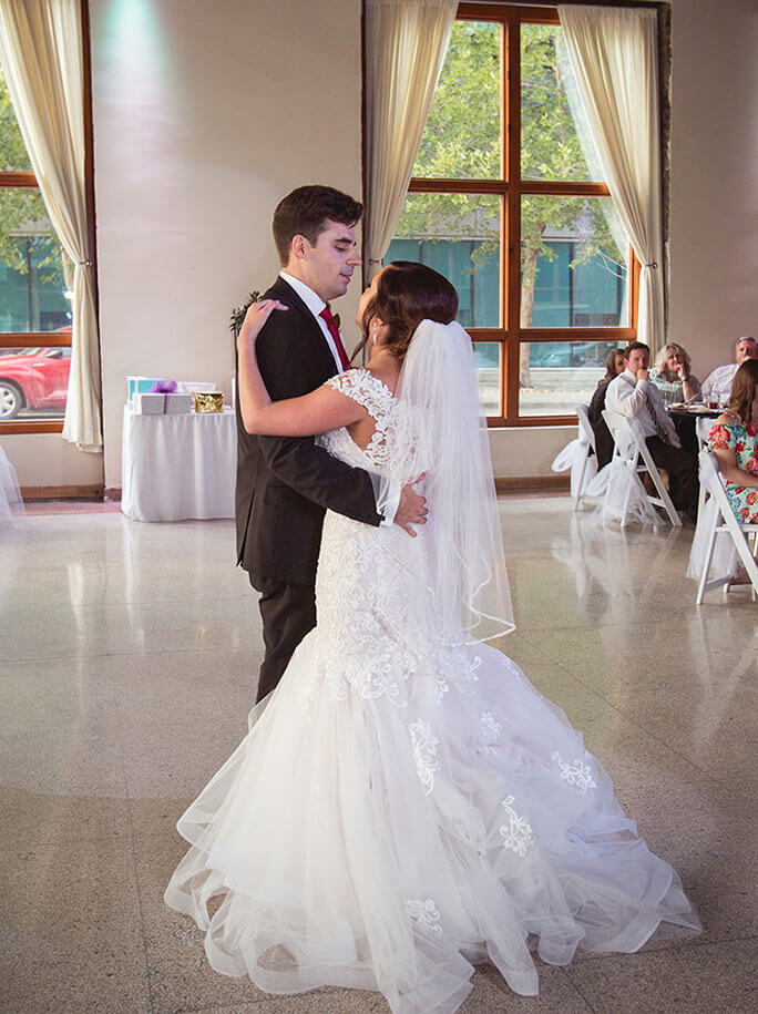 Belle Vogue Bride Kerry on the dance floor with her husband with her wedding dress bustled