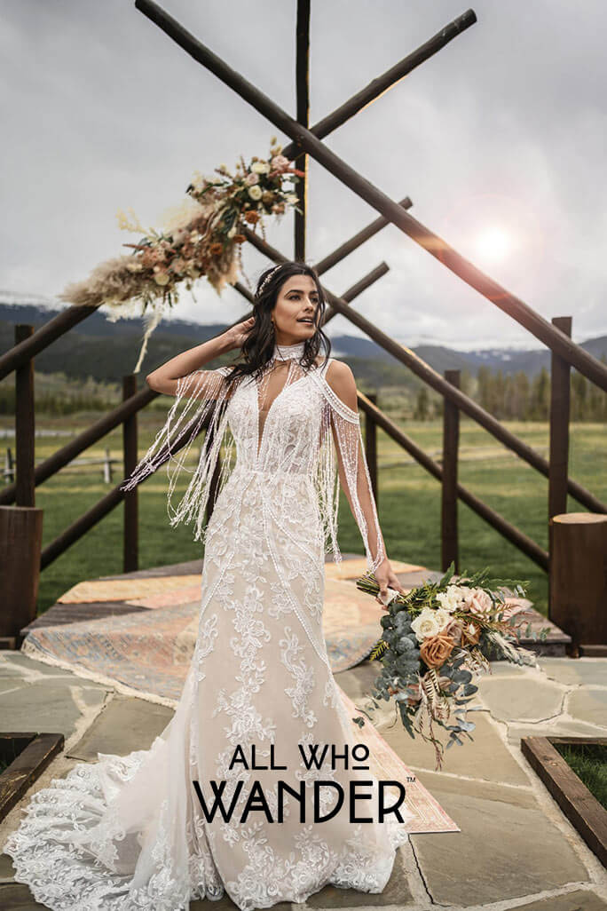 Boho Bride wearing the Avery wedding dress from the All Who Wander bridal gown collection