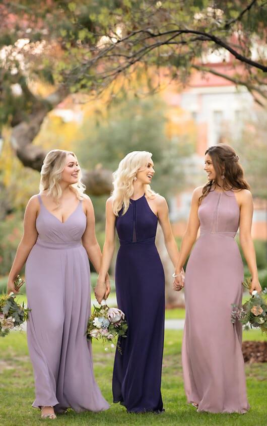 3 friends walking through a park in their Bridesmaid dresses from Sorella Vita