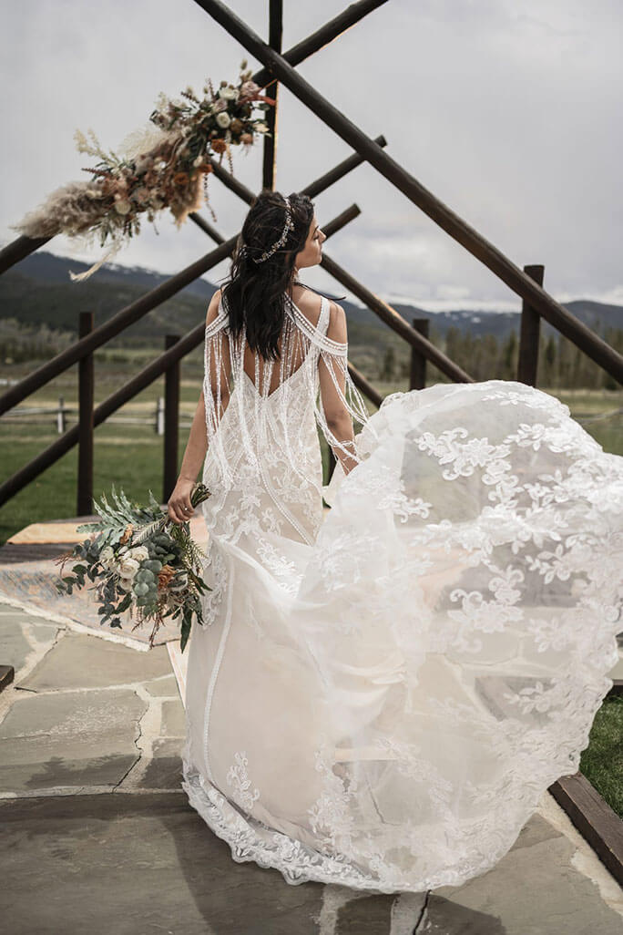Bride wearing a crown paired with her All Who Wander gown, style Avery
