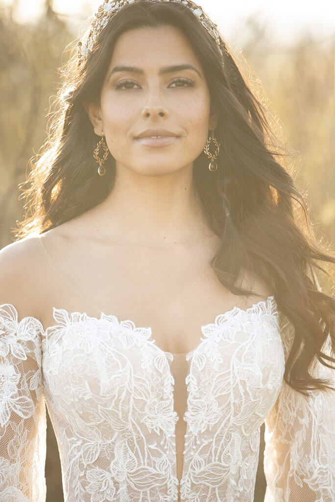 Bride wearing style Finn from bridal gown designer All Who Wander. She paired her wedding dress with a bridal headband.