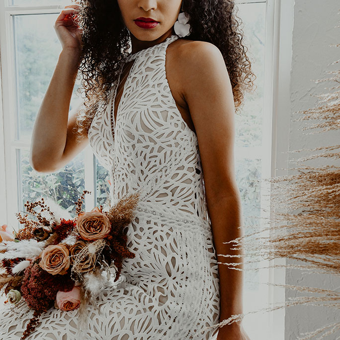 Bohemian bride wearing an All Who Wander wedding dress, style = Adley