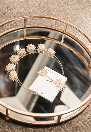 Bridal headband and hair pins on a table