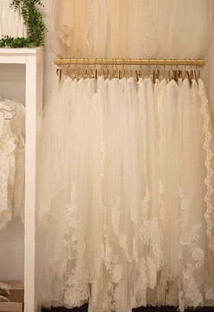 Bridal veils hanging on a wall