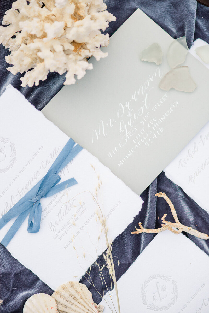 Trendy bride styled photo of wedding invitations