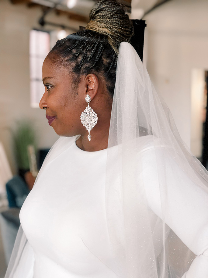 Side view of a bride wearing a Martina Liana wedding dress, style 1157 + 2050ST veil