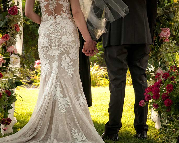 Christine and husband holding hands - style 6933 by stella york