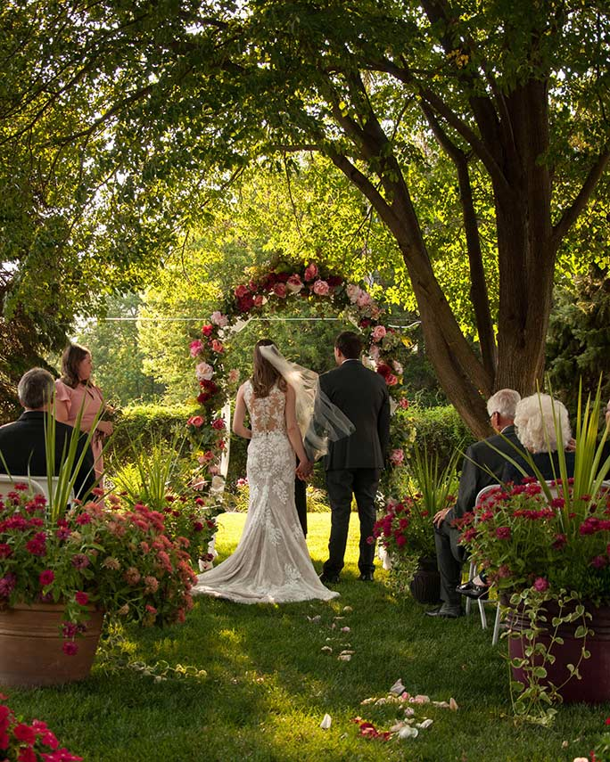 outdoor venue at christines wedding - style 6933 by stella york